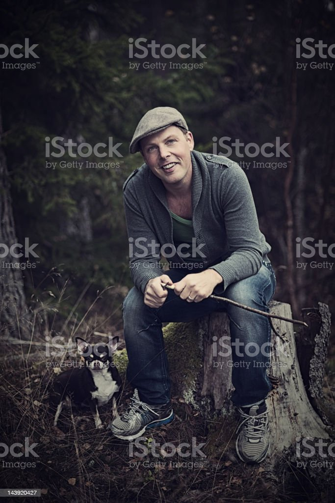 Handsome man outdoors with his chihuahua royalty-free stock photo