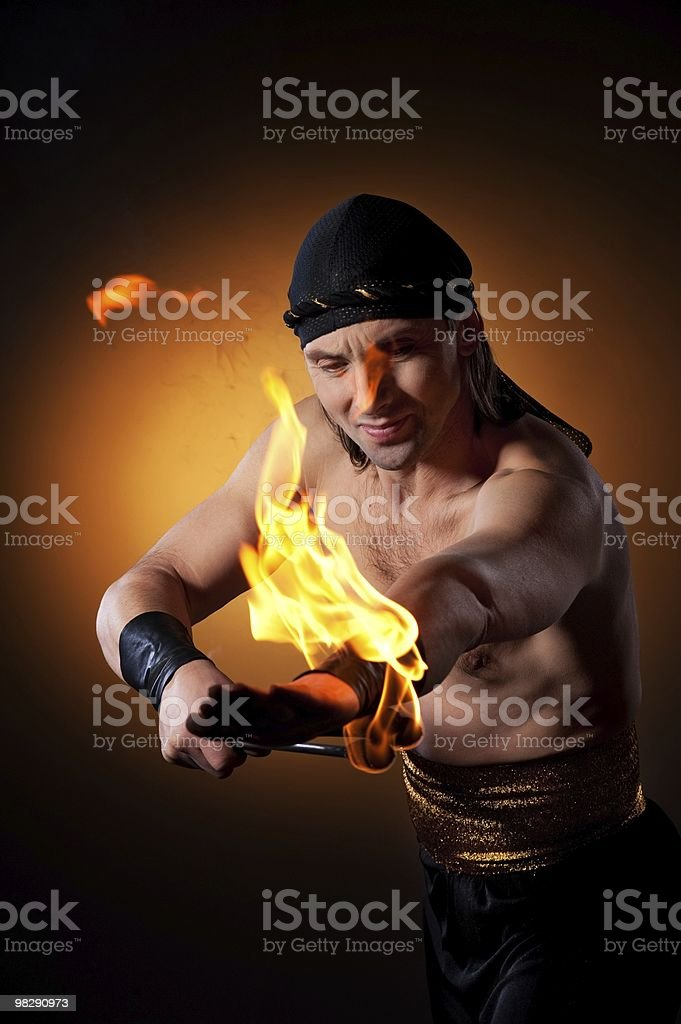 Handsome man performing fire show stock photo