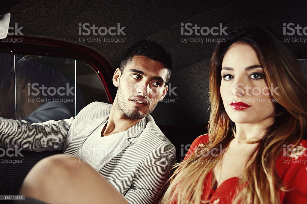Handsome man picking up blonde in his car stock photo