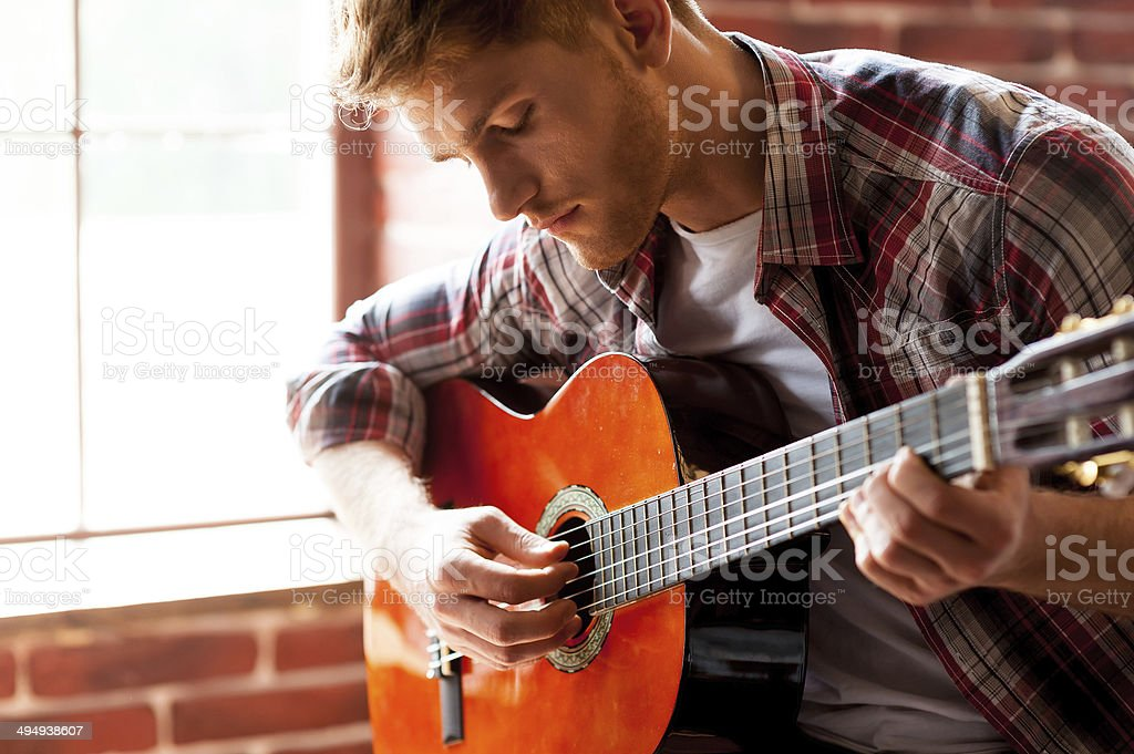Handsome man playing guitar. royalty-free stock photo