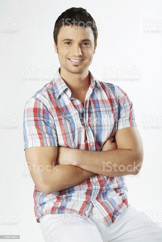 Handsome man portrait sitting arms crossed smiling stock photo