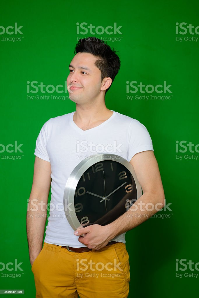 Handsome man posing with big watch stock photo
