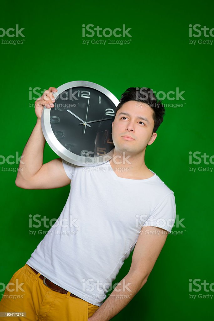 Handsome man posing with watch stock photo