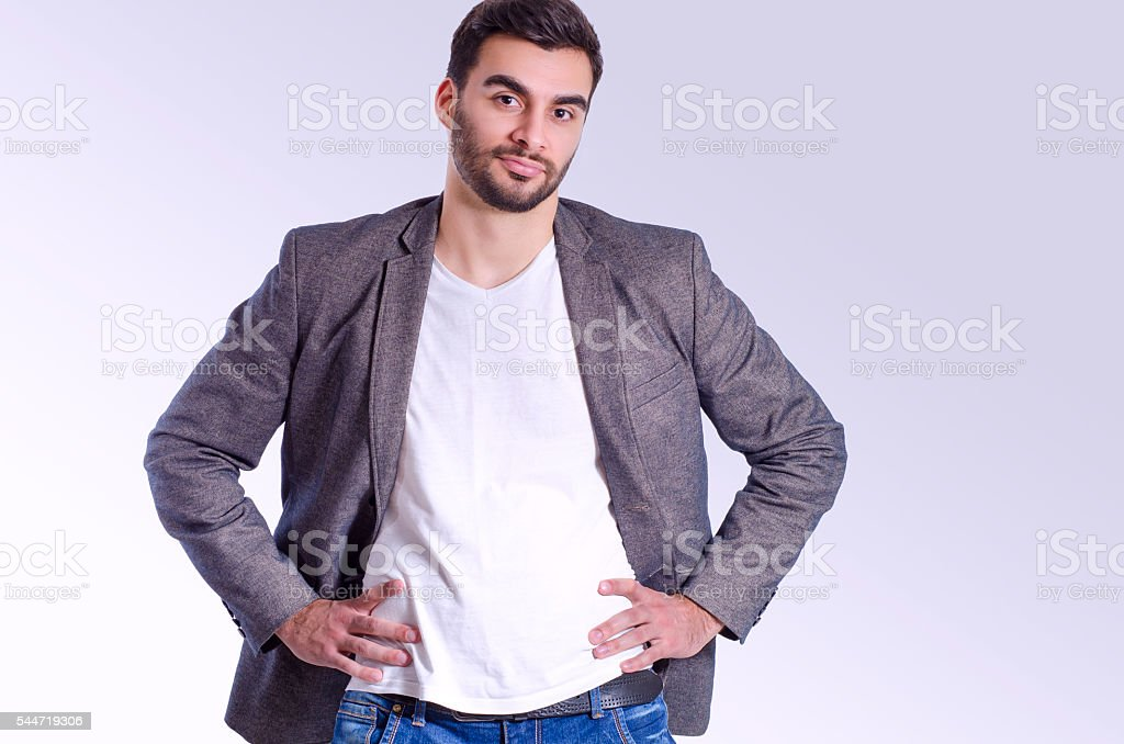 Handsome man, power posing stock photo