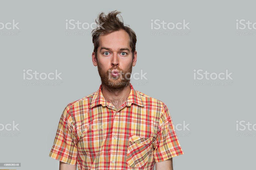 Handsome Man Puckering stock photo