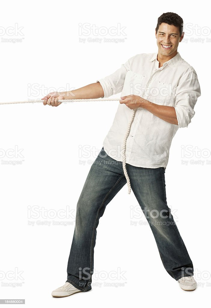 Handsome Man Pulling on a Rope stock photo