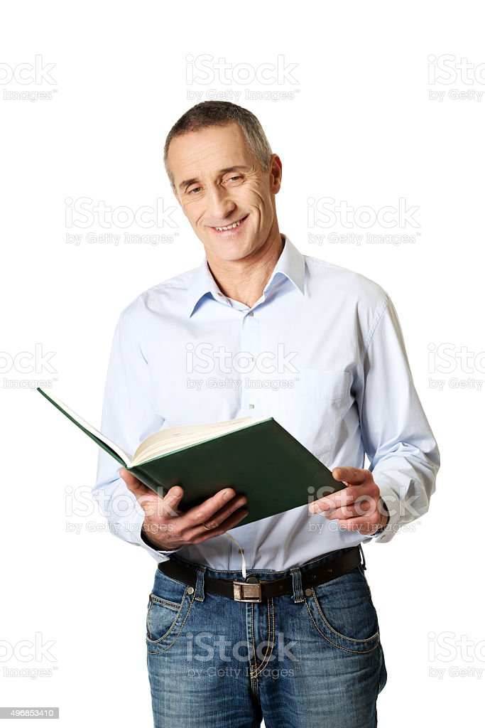 Handsome man reading his schedule stock photo