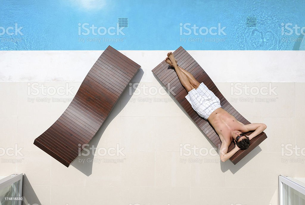 Handsome man relaxing at a private pool villa royalty-free stock photo