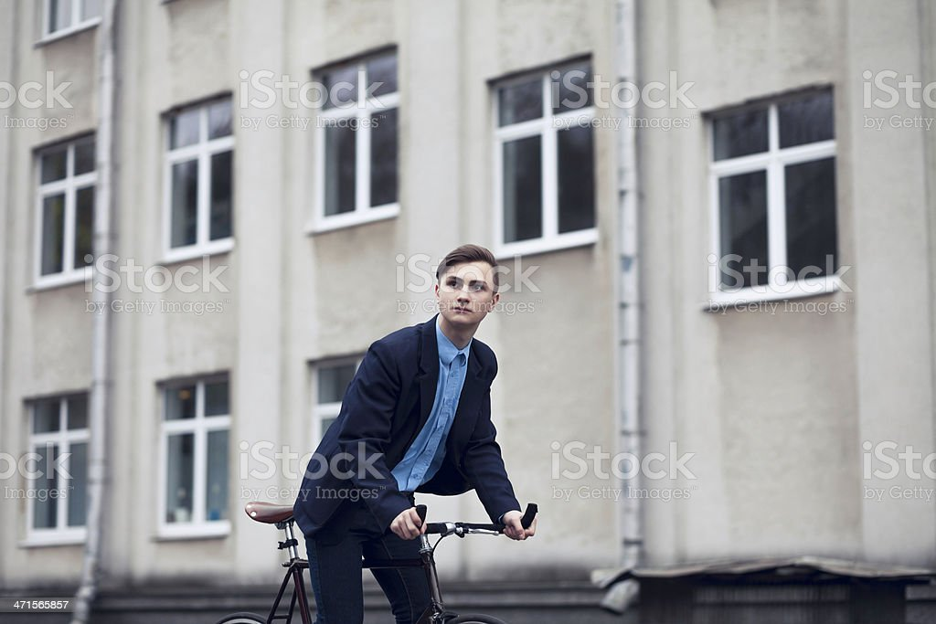 Handsome man riding bicycle royalty-free stock photo
