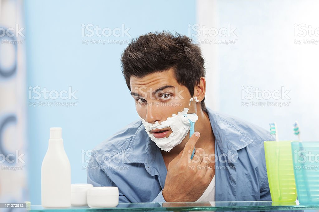 Handsome man shaving stock photo