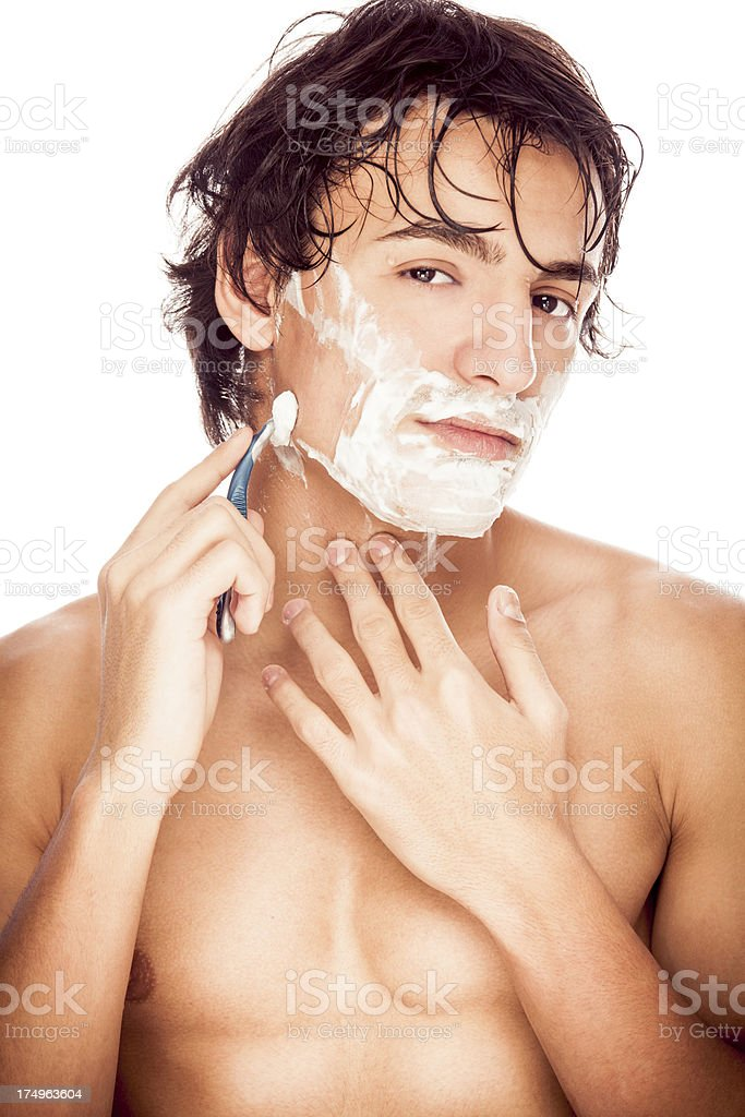 Handsome man shaving royalty-free stock photo