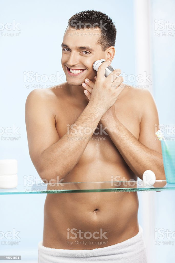 Handsome man shaving royalty-free stock photo