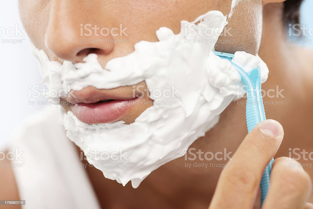Handsome man shaving stock photo