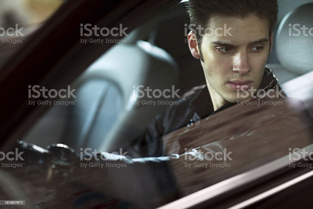 Handsome man siting in his car stock photo
