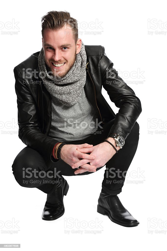 Handsome man sitting down stock photo