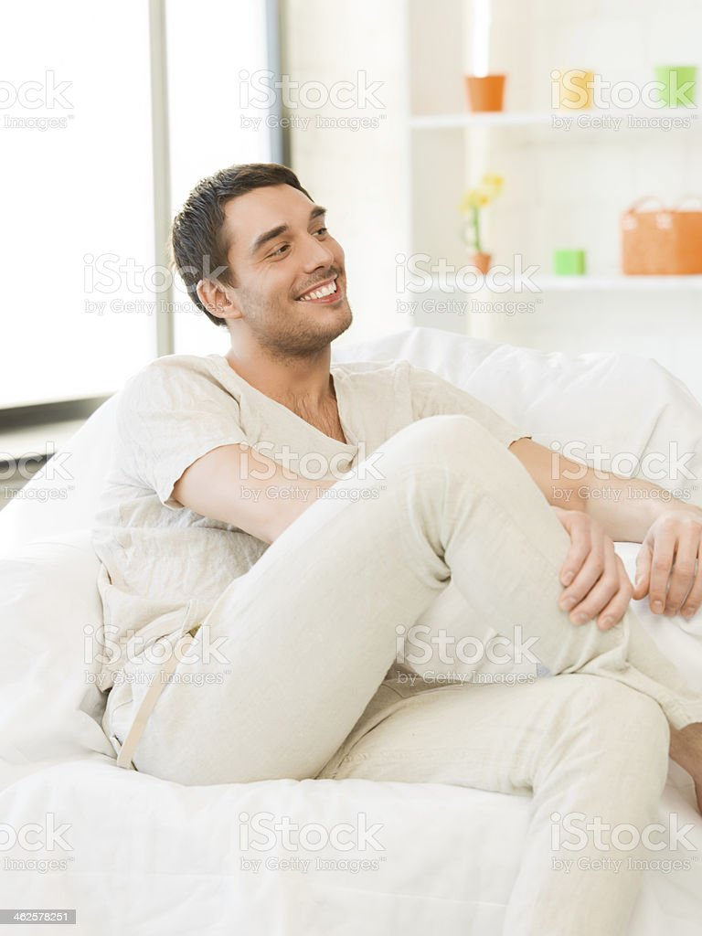 handsome man sitting on couch at home royalty-free stock photo