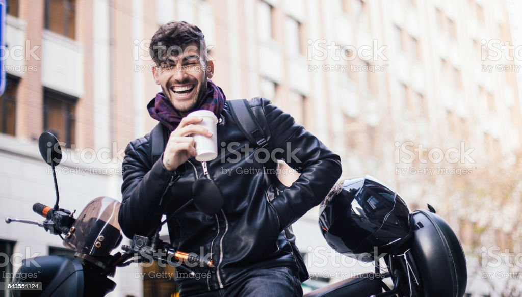 Handsome man sitting on motorcycle stock photo