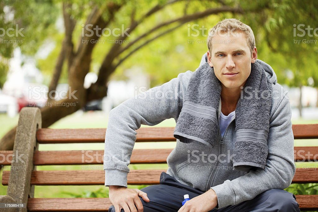 Handsome Man Sitting On Park Bench royalty-free stock photo
