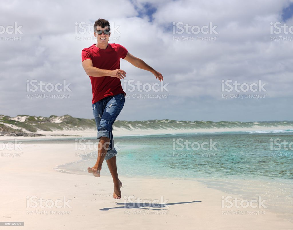 Handsome Man skipping down a secluded Beach (XXXL) royalty-free stock photo