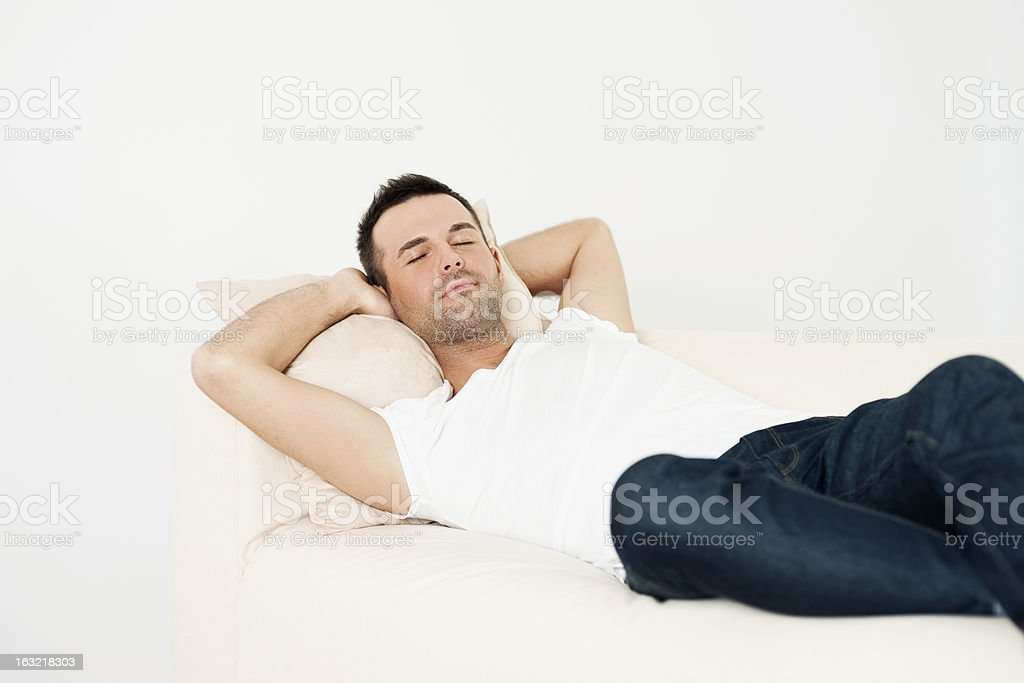 Handsome man sleeping on couch royalty-free stock photo