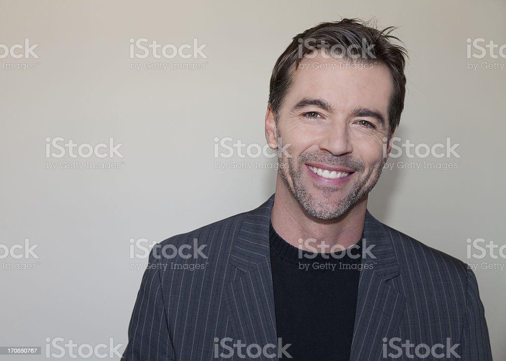 Handsome man smiling at camera royalty-free stock photo