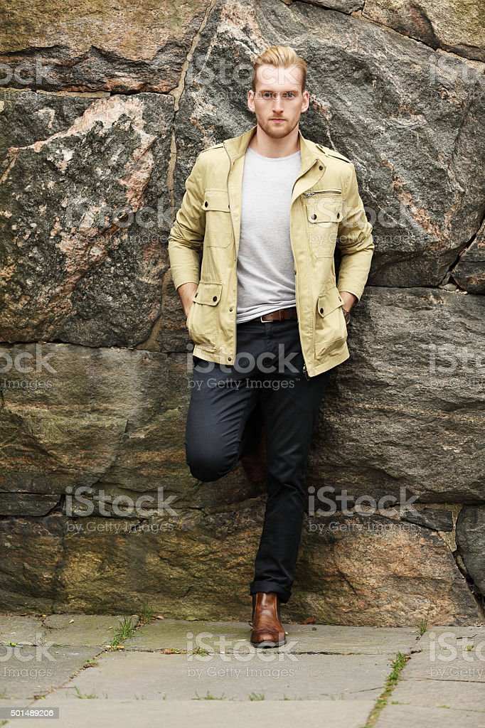 Handsome man standing outdoors stock photo