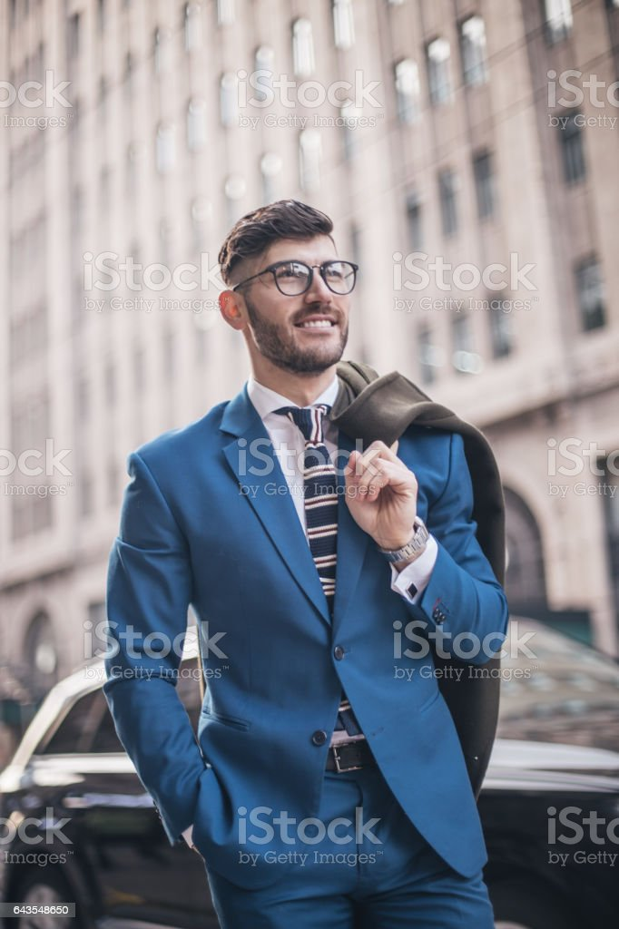 Handsome man suit on the street stock photo