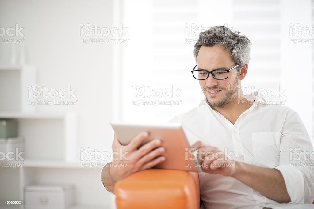 handsome man surfing on tablet stock photo