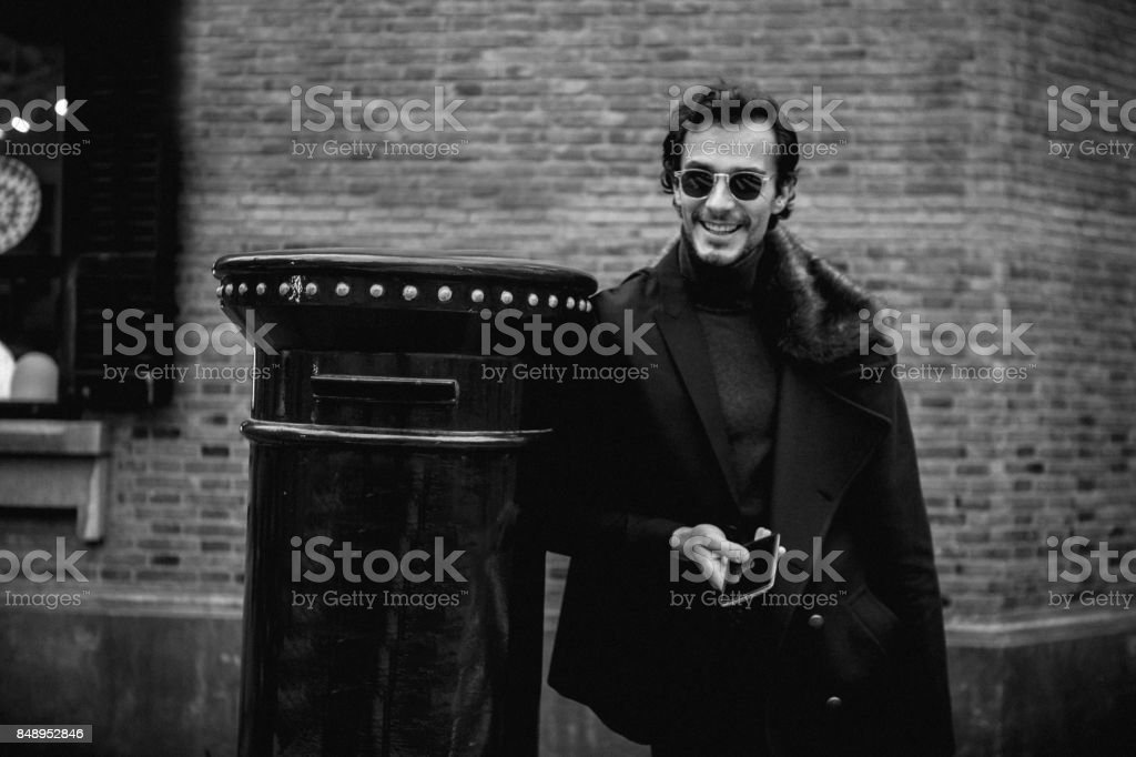 Handsome man texting stock photo