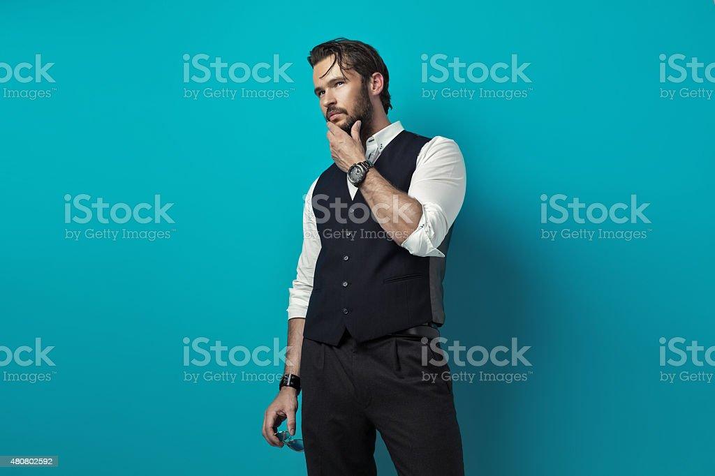 Handsome man thinking stock photo