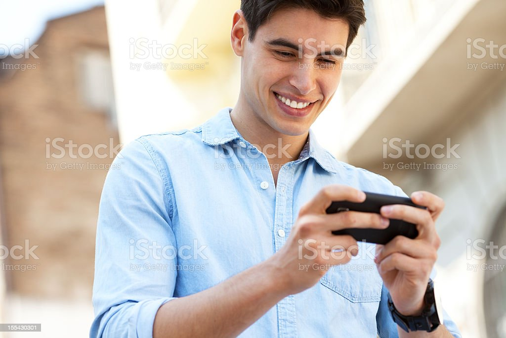 handsome man typing text message royalty-free stock photo
