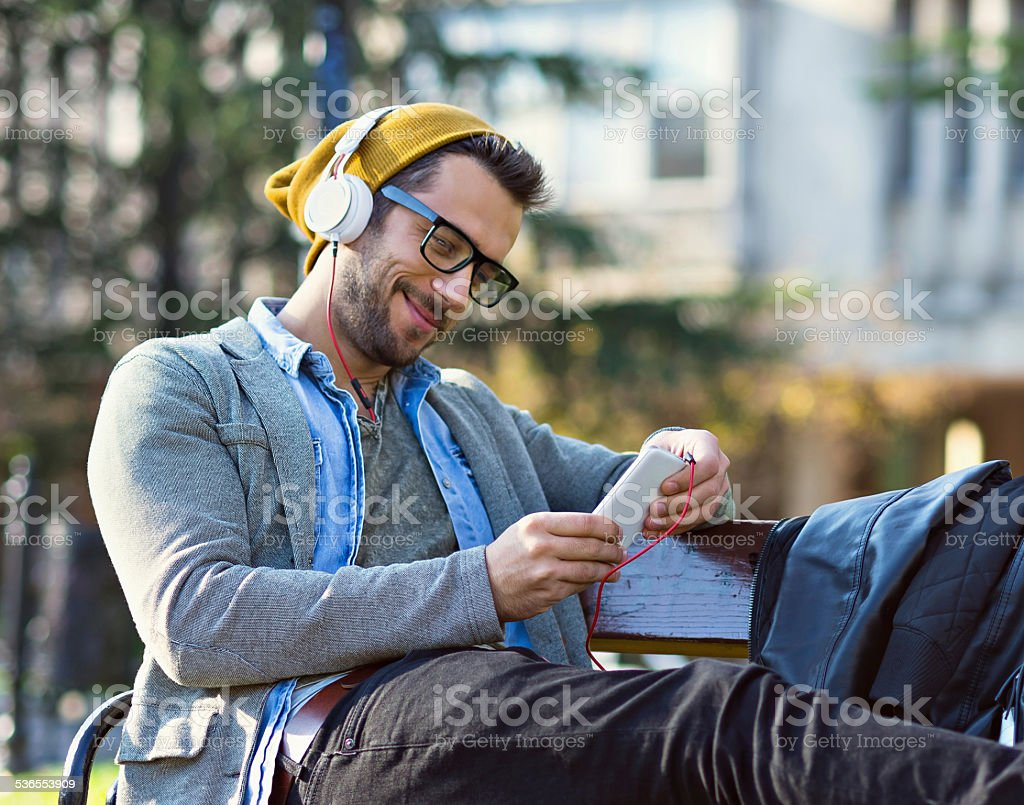 handsome man typing text message stock photo