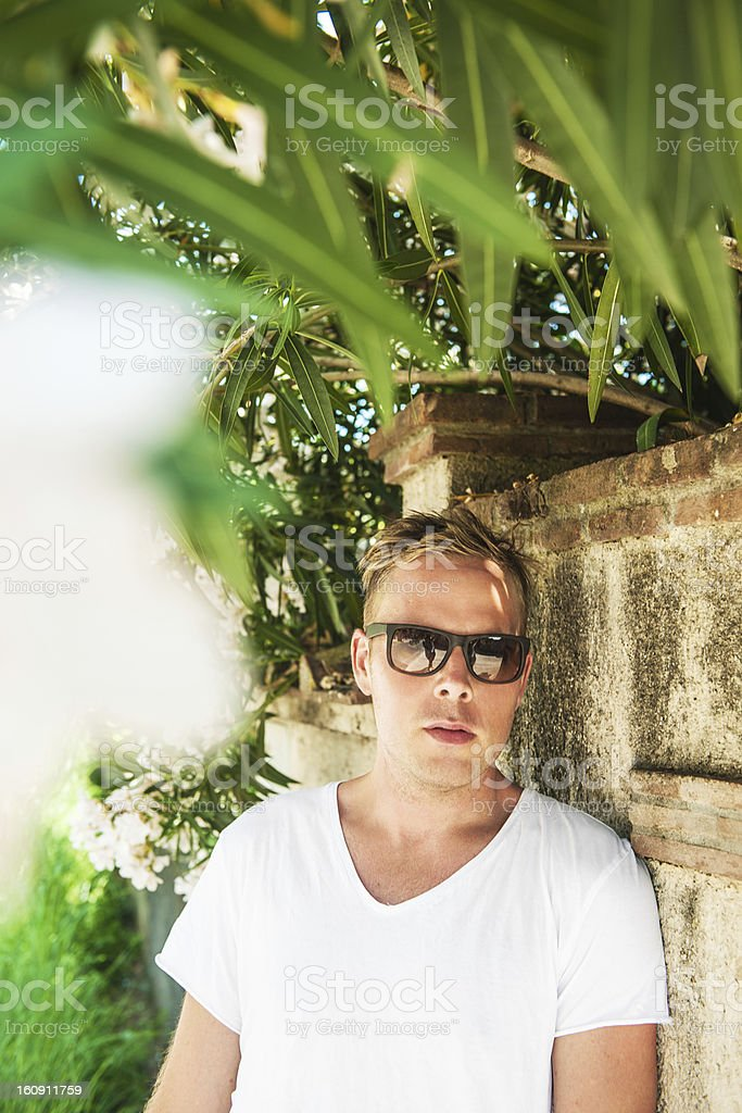 Handsome man under a oleander royalty-free stock photo