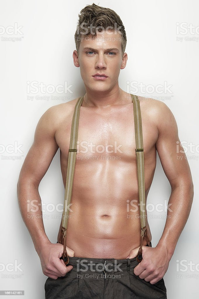 Handsome Man Undressed with Suspenders royalty-free stock photo