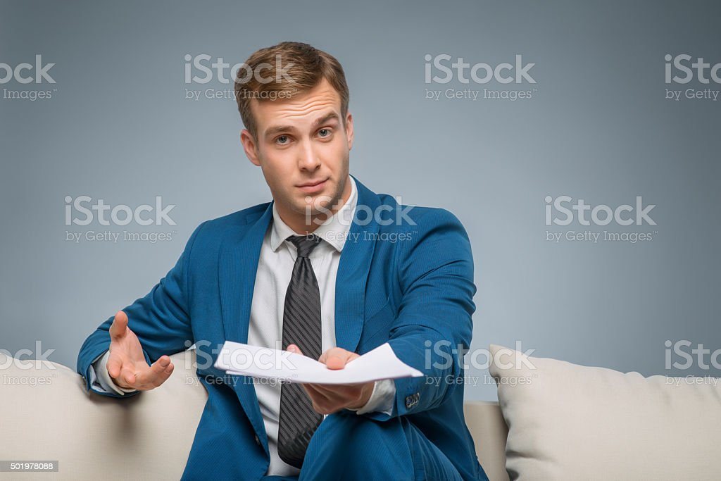 Handsome man upholding official papers stock photo