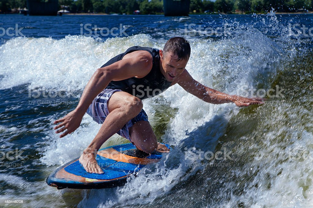 Handsome man urfing in a lake royalty-free stock photo