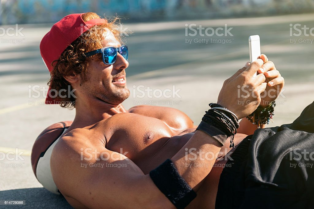 Handsome Man Using a Mobile Phone. stock photo