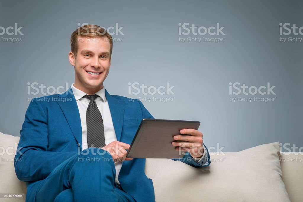 Handsome man using a tablet stock photo