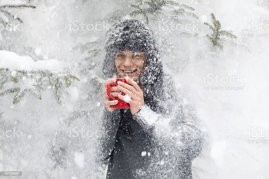 Handsome man warming up with a cup of tea. stock photo
