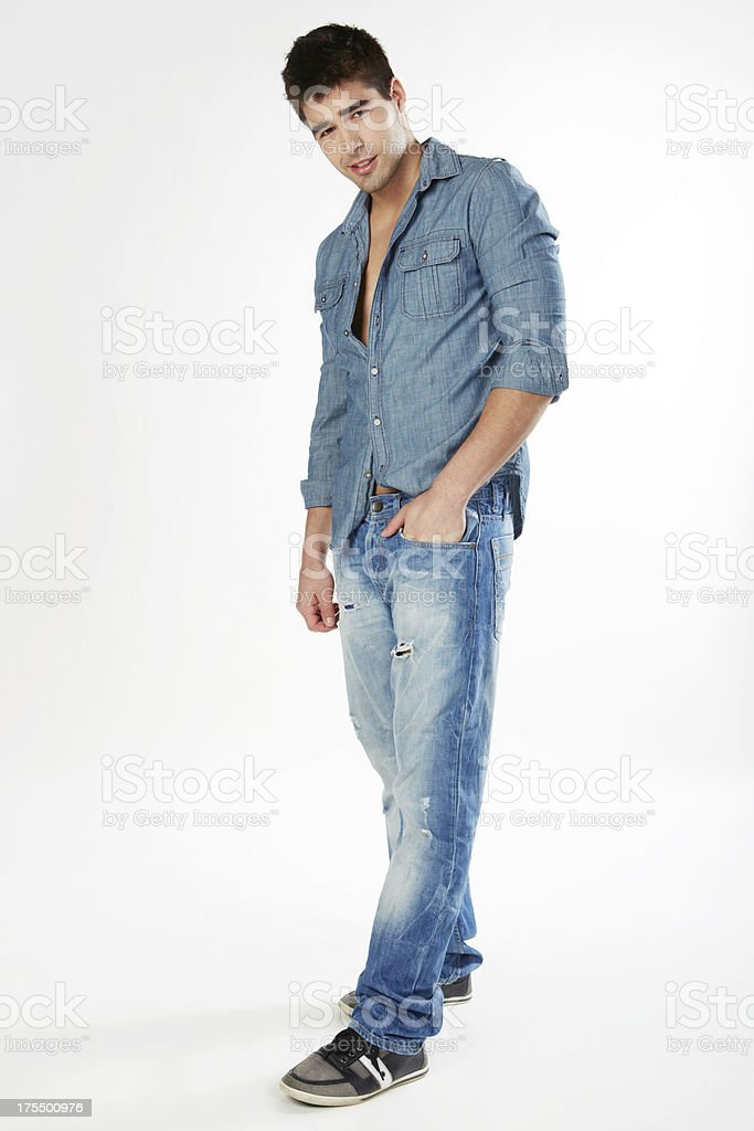 Handsome man wearing jeans hand in pocket smiling stock photo