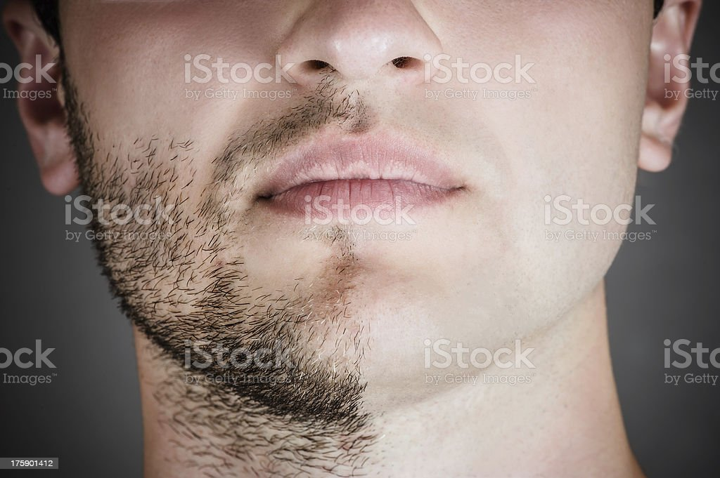handsome man with a shaved half his face stock photo