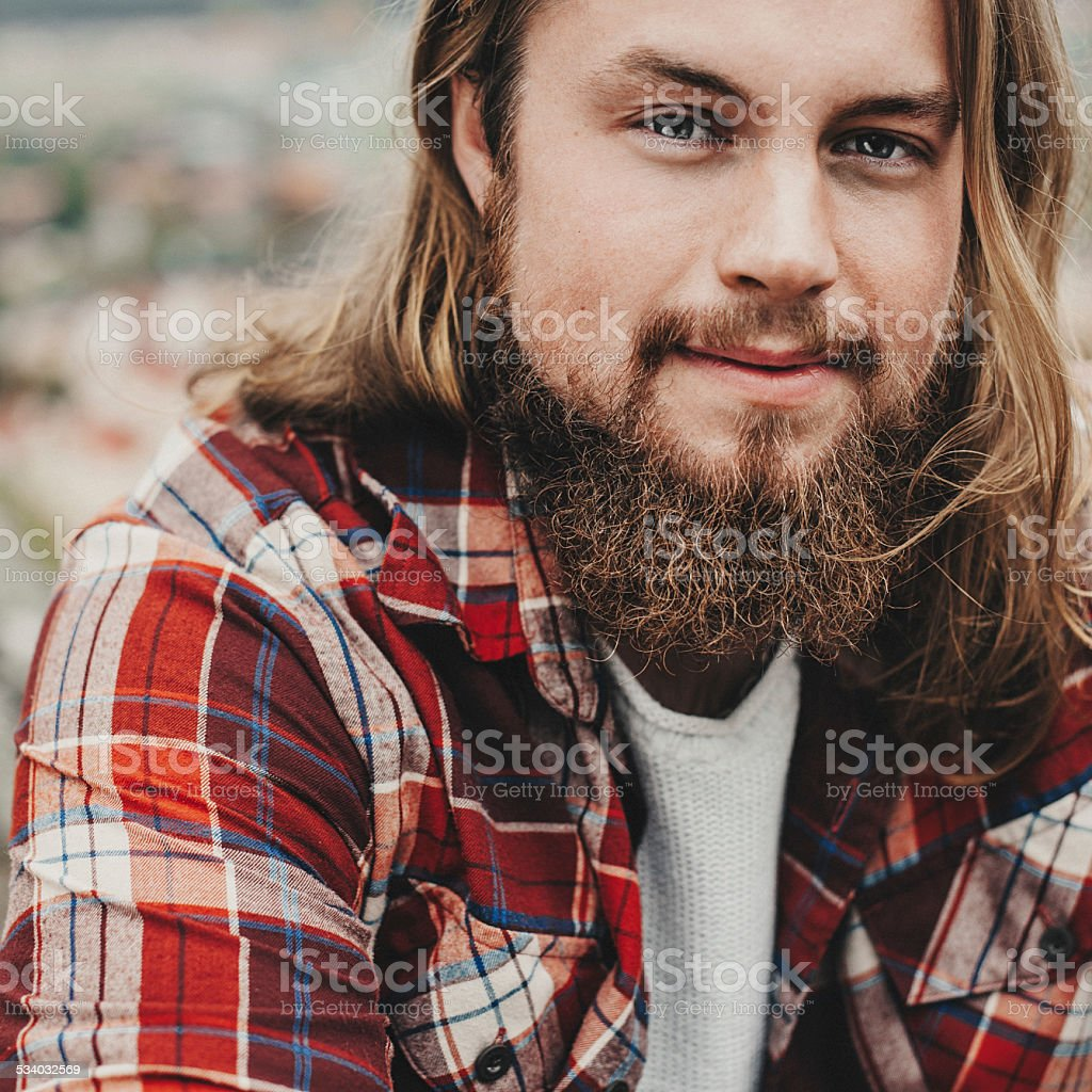 Handsome man with beard outdoors in nature stock photo
