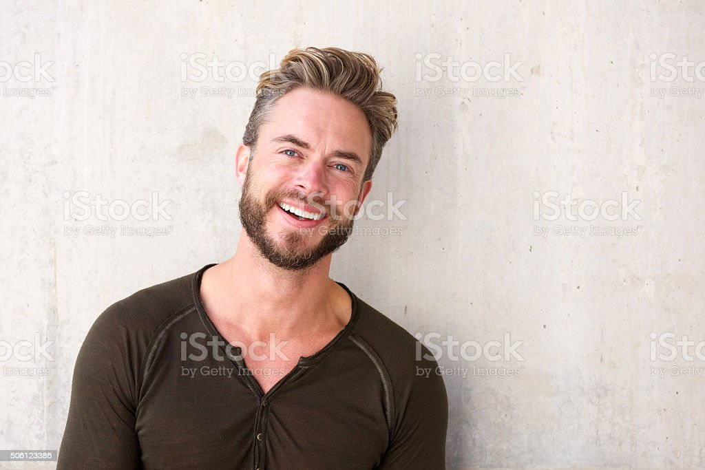Handsome man with beard smiling stock photo