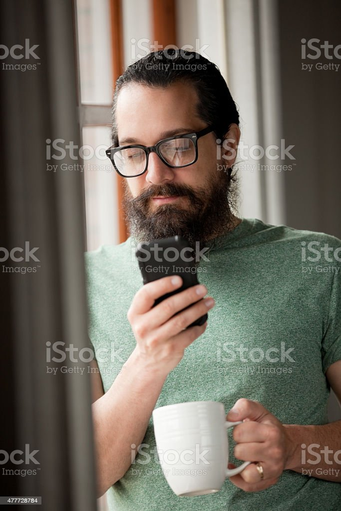 Handsome Man With Beard Texting stock photo