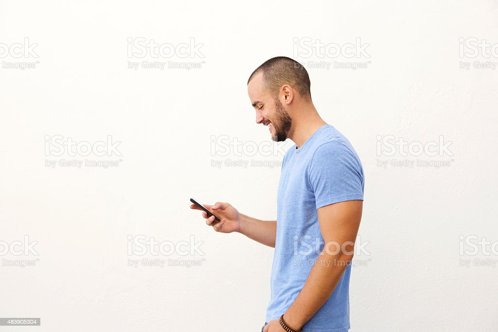 Handsome man with beard walking with mobile phone stock photo