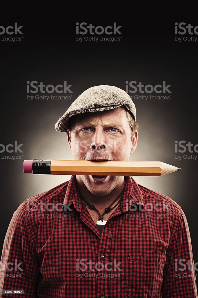 Handsome man with big pencil royalty-free stock photo