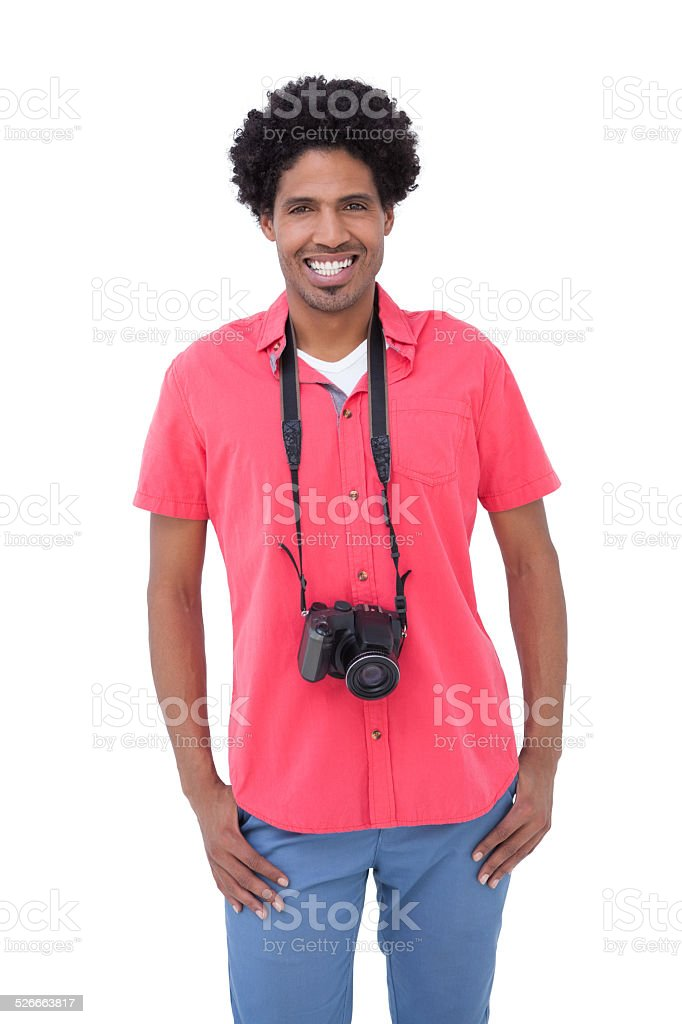 Handsome man with camera around his neck stock photo