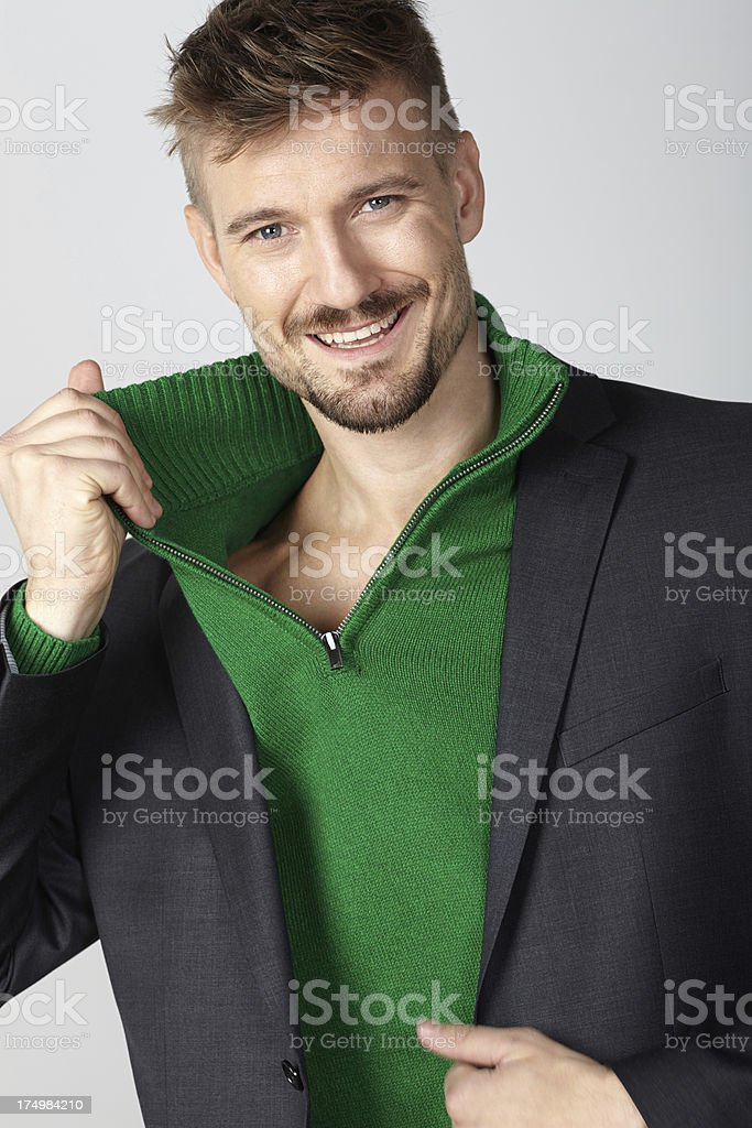 Handsome man with casual business jacket smiling royalty-free stock photo