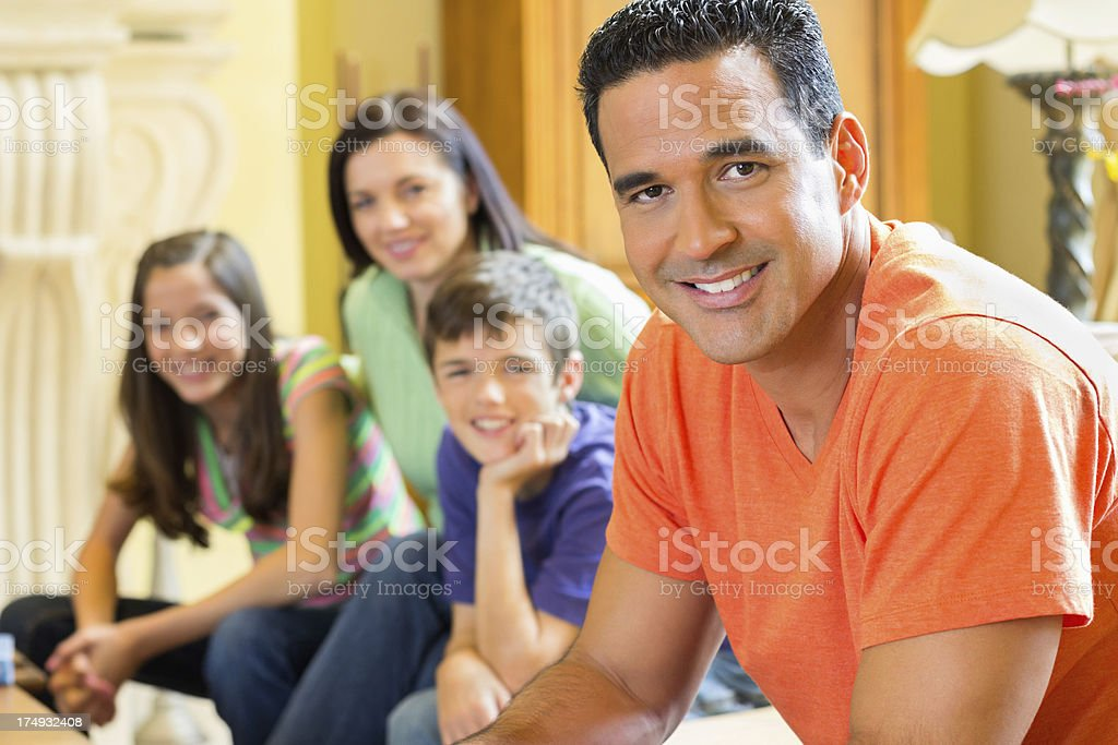 Handsome Man With Family In Background royalty-free stock photo