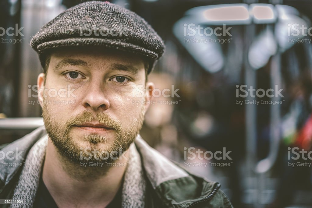 Handsome man with flat cap traveling in train stock photo